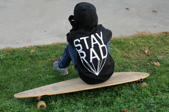 Fall Stay Rad sitting on board Silly Souls lifestyle